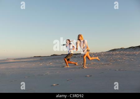 Boy and Girl throwing stones - Stock Photo