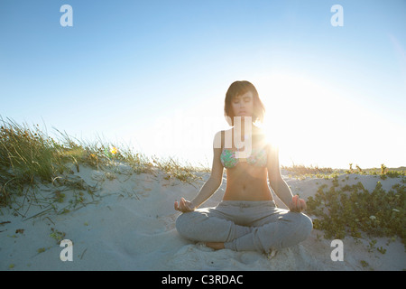 Girl doing yoga - Stock Photo