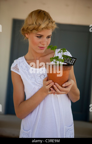 Girl with parsley - Stock Photo