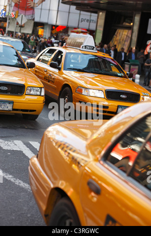 Yellow cabs in Times Square, New York City, USA - Stock Photo