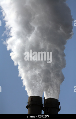 Smoking chimneys of the Reuter West power plant, Berlin, Germany - Stock Photo