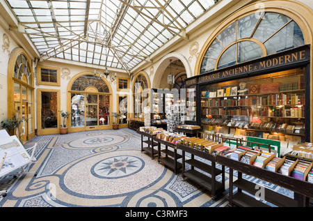 Secondhand bookshop in the Galerie Vivienne in the 2nd Arrondissement, Paris, France - Stock Photo