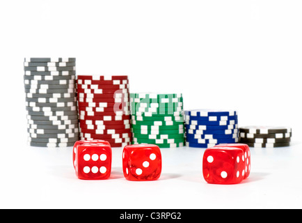 Dice with chips gabling, isolated on white background - Stock Photo