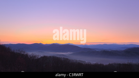 Sun rising over snowy mountains of Smokies in early spring with ...