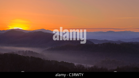 Sun Rising Over A Snowy Mountain Stock Photo | Getty Images