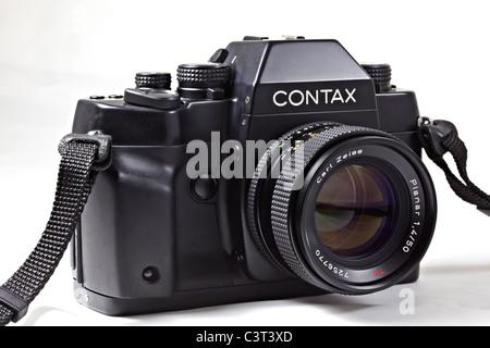 Film camera. Legendary Contax RX 35mm SLR designed by Porsche Carl Zeiss Planar - Stock Photo