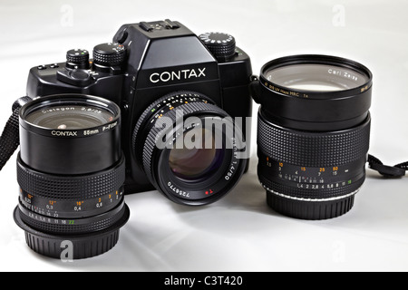 Film camera. Legendary Contax RX 35mm SLR designed by Porsche and complete with Carl Zeiss lenses. - Stock Photo