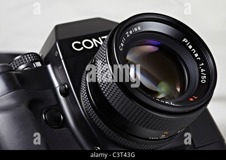 Film camera. Legendary Contax RX 35mm SLR designed by Porsche and shown here with a Carl Zeiss 50mm f1.4 Planar - Stock Photo