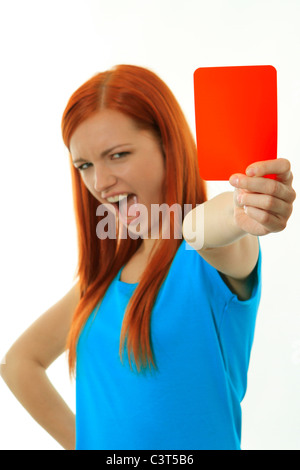 Young woman shows the red card - Stock Photo