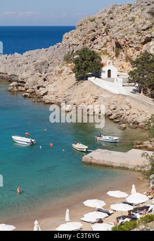 St Pauls Bay Beach and Chapel Lindos Rhodes Greece - Stock Photo