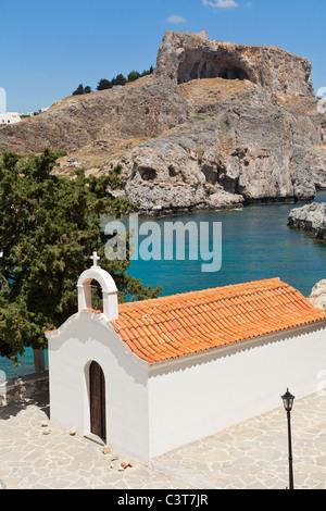 St Pauls Bay Chapel with Acropolis Lindos Island Rhodes Greece - Stock Photo