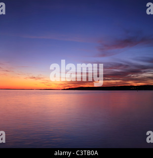 Movement During This Long Exposure Creates Brush Stroke Clouds Just After Sunset Over Gloucester Bay; Gloucester, - Stock Photo