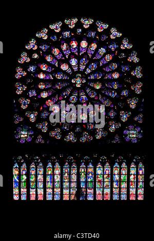 Stained glass Rose window in the Cathedral of Notre Dame de Paris, Ile de la Cite, Paris, France - Stock Photo