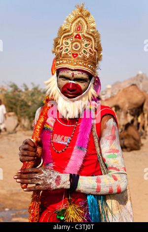 Indian people and daily life during the annual camel fair in Pushkar, Rajasthan, India, Asia. Man dressed as Hanuman - Stock Photo