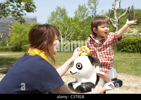 Mother and Son in Playground - Stock Photo