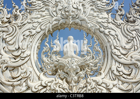 sculpture detail of buddhist white temple wat rong khun, chiang rai, thailand - Stock Photo