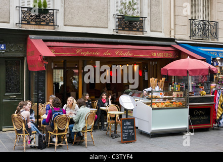 Sidewalk cafe near the Cathedral of Notre Dame de Paris, Ile de la Cite, Paris, France - Stock Photo