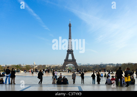 Tourists viewing the Eiffel Tower from the Trocadero in the late afternoon, Paris, France - Stock Photo