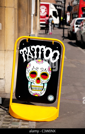 A sign for tattoos outside a tattoo parlour, Cambridge UK - Stock Photo