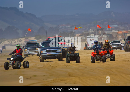 ATV's and passenger vehicles driving on the sand at Oceano Dunes State Vehicular Recreation Area, Oceano, California - Stock Photo