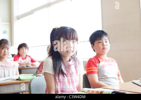Schoolchildren in Classroom - Stock Photo