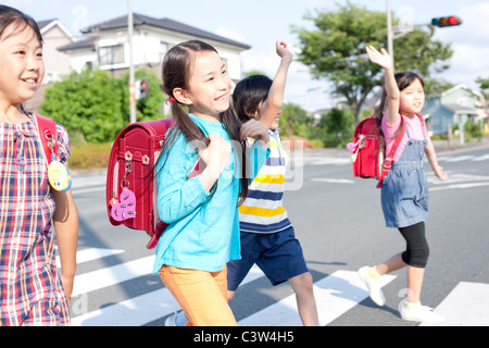 Kids crossing street, Japan - Stock Photo