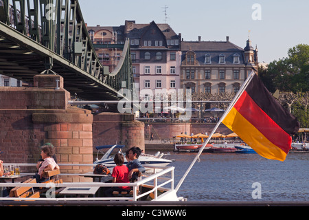 Relaxing on a boat on the River Main on a glorious late Spring day in Frankfurt, Germany. - Stock Photo