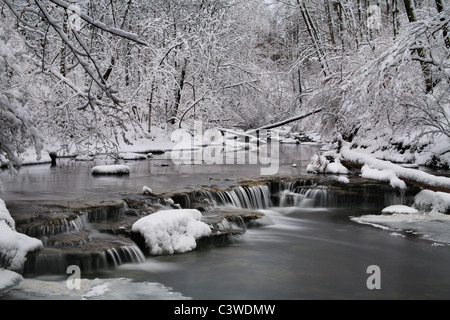 A Snow Covered Little Creek And Waterfall In Winter, Keehner Park, Southwestern Ohio, USA - Stock Photo
