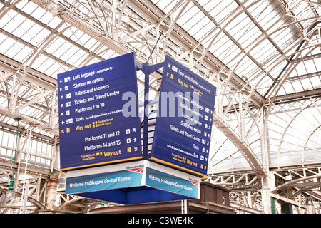 Overhead directional sign in the concourse of Glasgow Central Station. indicating locations of platforms and station - Stock Photo