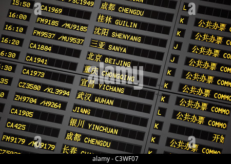 Coach schedule information board in Pudong airport,Shanghai,China. - Stock Photo
