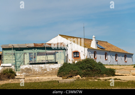 Fishermen's houses on the Ria Formosa Nature Park Faro , Algarve , Portugal - Stock Photo