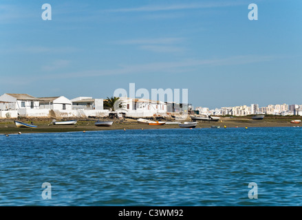 Fishermen's houses on the Ria Formosa with Faro in the background , Algarve , Portugal - Stock Photo