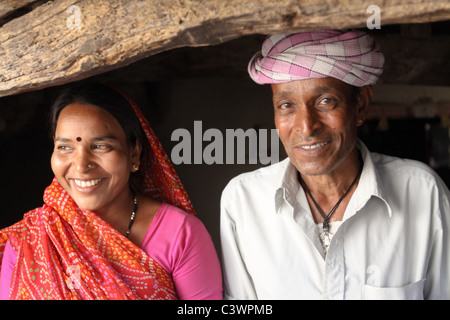 A tribal couple dressed in traditional clothes in Udaipur, Rajasthan, India - Stock Photo