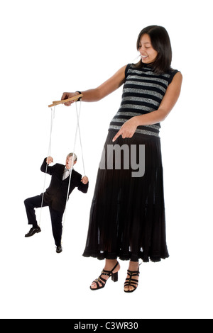 Young employee with her boss on strings - Stock Photo