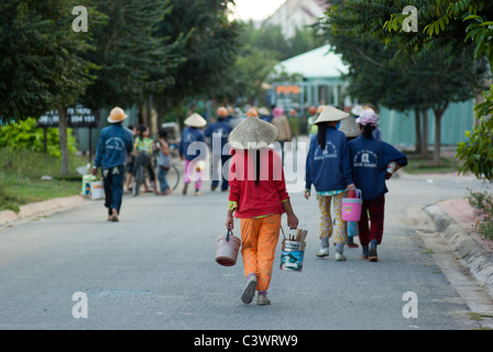 Female construction workers leaving the site after their shift - Stock Photo