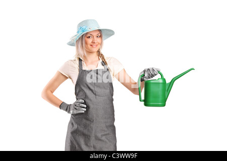 A beautiful female gardener with watering can - Stock Photo