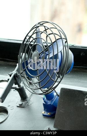 antique Electric Fan in a old bus - Stock Photo