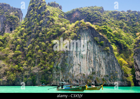 Tourist boats cruising Phang Nga Bay, Phuket Thailand - Stock Photo