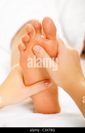 Foot massage and spa foot treatment. - Stock Photo