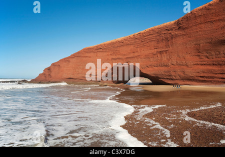 Rock arches on the Legzira beach on the Atlantic Ocean, 11 km north of the town of Sidi Ifni in southwest Morocco. - Stock Photo