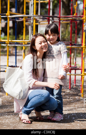 Mother and Daughter in Playground - Stock Photo