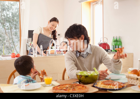 Family of Four Having Lunch - Stock Photo
