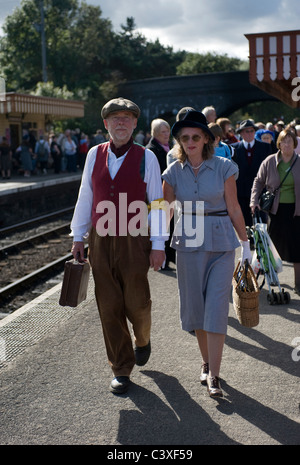 couple dressed in 1940's period costume weybourne station norfolk uk - Stock Photo