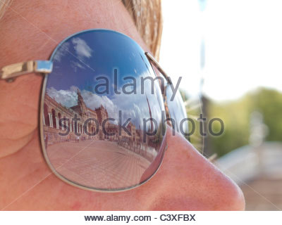 Close up of Plaza de Espana reflected in tourist's sunglasses, Seville, Spain - Stock Photo