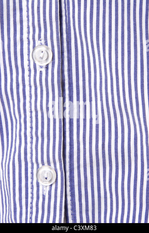 white and blue striped shirt, button detail - Stock Photo