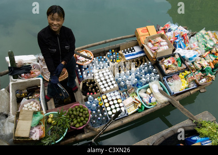 A water market at Hang Dau Go (Cave of Wooden Stakes) in Halong Bay. - Stock Photo