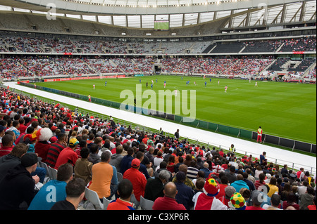 Supports watching a football match in Cape Town Stadium, Cape Town, Western Cape, South Africa - Stock Photo