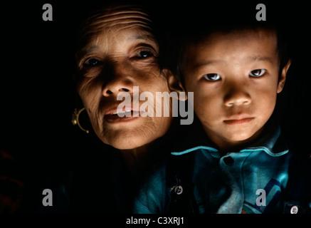 Portrait of a Tibetan Grandmother and Grandson. Lhasa, Tibet, China. - Stock Photo