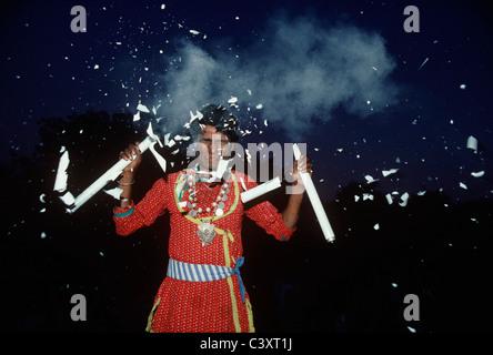 Indian Street Performer Smashes Light Bulbs on His Head. New Delhi, India - Stock Photo
