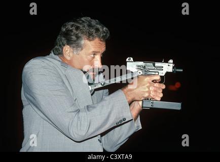 Israeli Secret Service agent draws an uzi pistol from his shoulder holster. Israel - Stock Photo